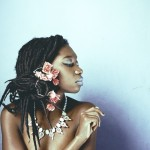 Just beautiful locs with flowers and a necklace