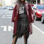 Burgundy coat, big glasses and black skirt. Fashion !