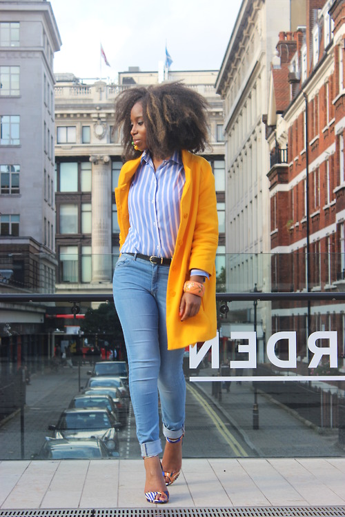 Gorgeous hairstyle, jeans and yellow coat