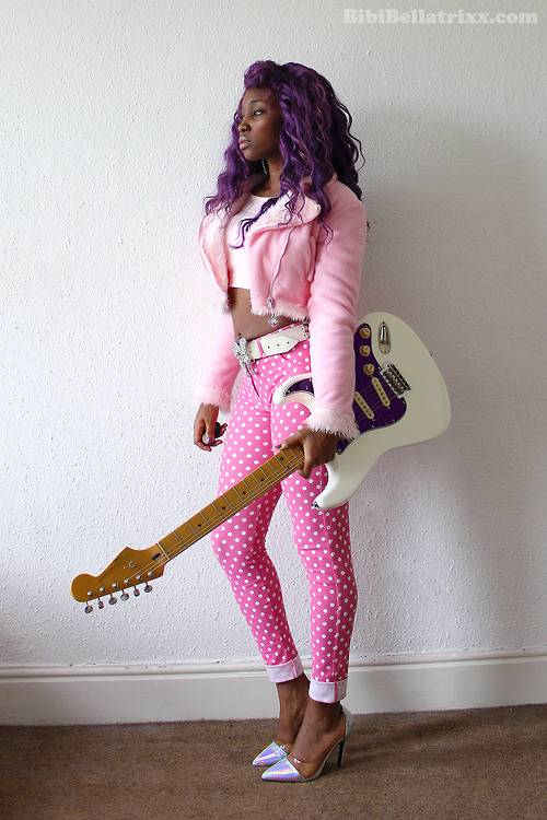 Purple hairstyle, pink jacket and slim pants