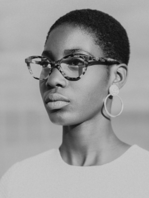 Short hairstyle, nice glasses and earings