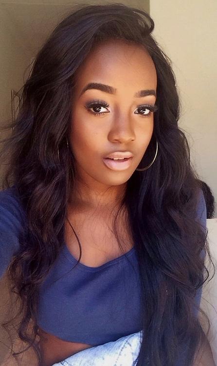 Long smooth wavy hair and perfect makeup