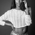 Eugena Washington wears denim shorts and short top