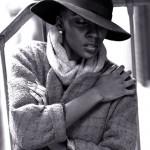 Destiny Owusu wears a hat, scarf and wool jacket