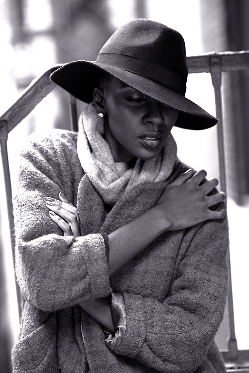 Destiny Owusu wears a hat, scarf and wool jacket