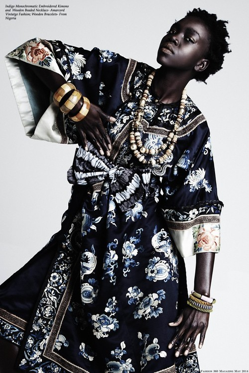 African fashion : embroidered kimono, wooden beaded necklace, bracelets