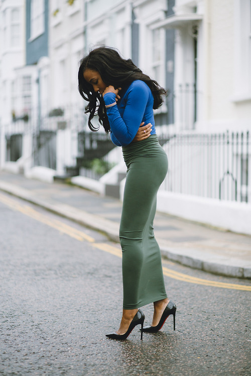 Heels, tight blue top and green skirt