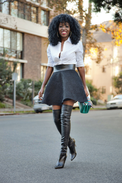 Curly hair, white shirt, black skirt and over the knee boots
