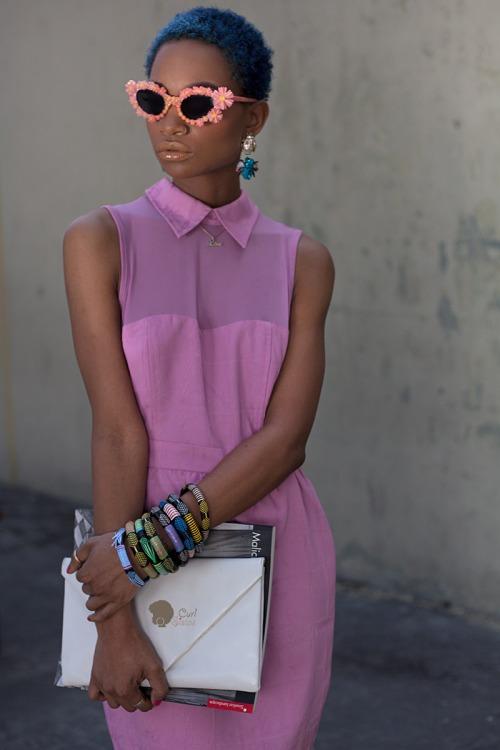 Short blue hair, amazing glasses, pink dress and bracelets