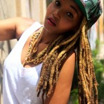 Locs, cap and sleeveless top