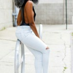 Grey gorgeous hairstyle, slim torn jeans and heels