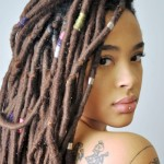 Locs, piercing and tattoo