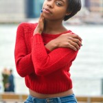Nice short hairstyle, red pullover and jeans