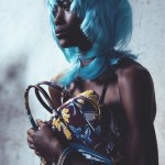 Betty Adewole handbag by Louis Vuitton and blue hairstyle