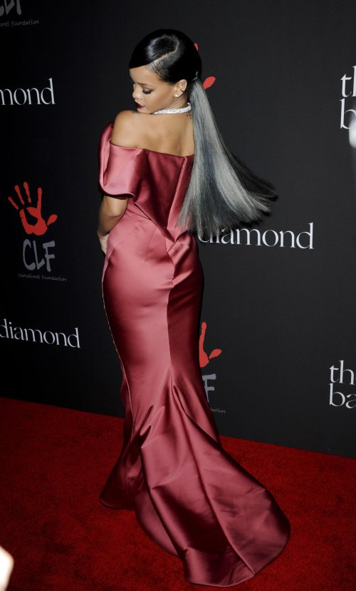 Rihanna ponytail hairstyle and Zac Posen dress