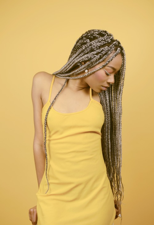 Long braids hairstyle and yellow dress