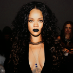 Rihanna long curly hair and black lips