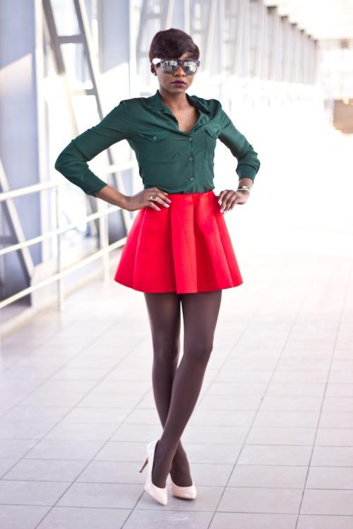 Green shirt and short red skirt