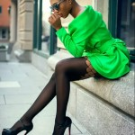 Short green hairstyle, green coat, sunglasses and heels