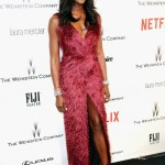 Naomi Campbell is wearing a Burberry dress and Bulgari Serpenti Jewelry