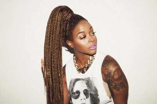 Chrisette Michelle shoulder tattoo and long golden braids