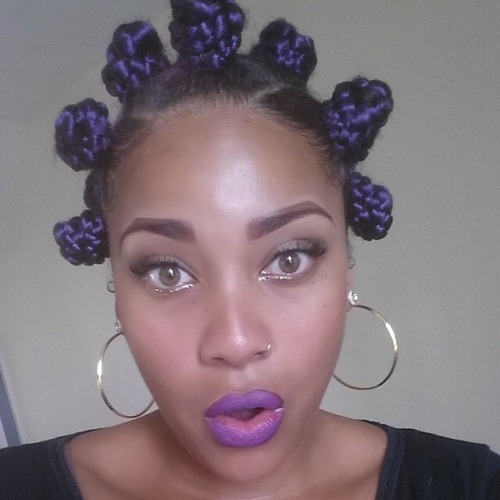 Purple bantu knots hairstyle
