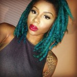 Blue locs hairstyle and shoulder tattoo
