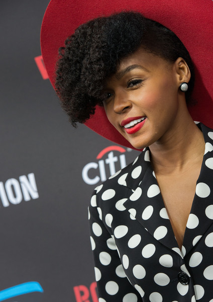 Janelle Monáe amazing hairstyle with red hat