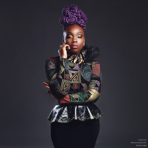 Amazing purple hairstyle and african style jacket