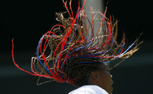 Venus Williams colored twists hairstyle in action