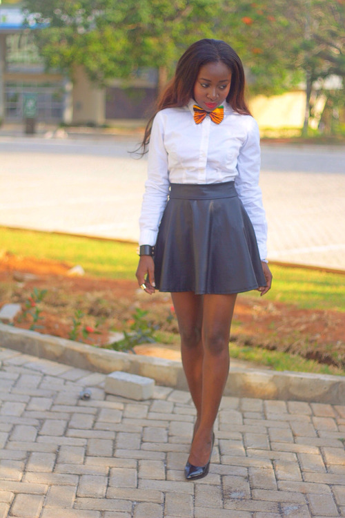 Leather skirt, white shirt, bow tie and long smooth hair