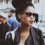 Big bun with braids hairstyle, RayBan sunglasses and leather jacket... So beautiful !