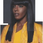 Songstress Dawn Richard long smooth hair and yellow jacket