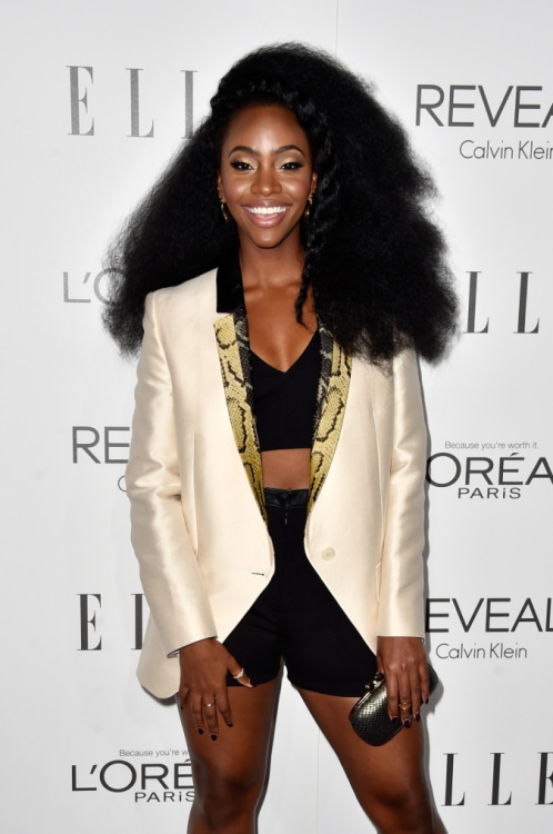 Teyonah Parris gorgeous hairstyles, black shorts and nice jacket