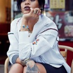 Rihanna with many rings and short straight hairstyle