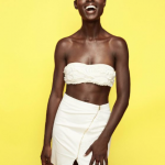 Jodie Smith white short skirt and short natural hairstyle