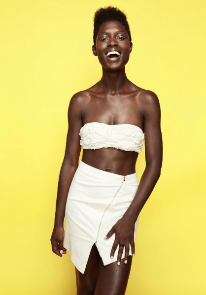 Jodie Smith white short dress and short natural hairstyle