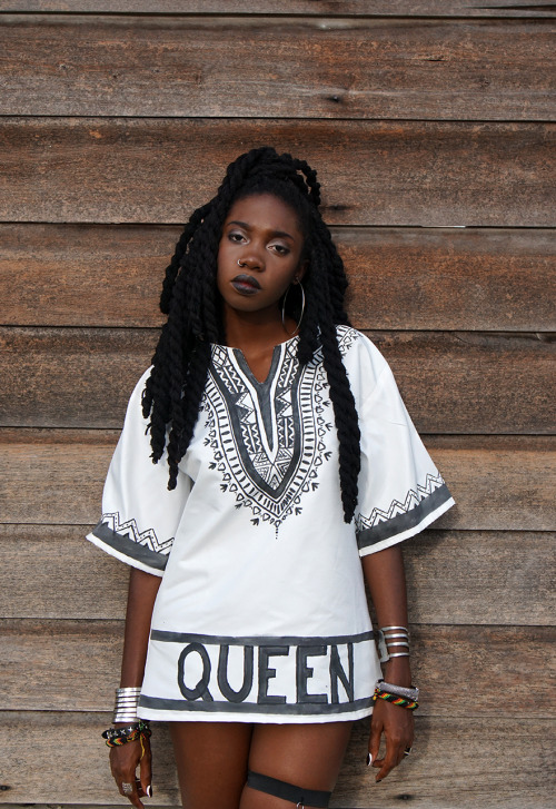 Afro punk style with twists hairstyle, nice dashiki hand painted, bracelets...