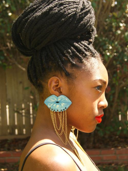 African style earrings and big bun hairstyle with braids