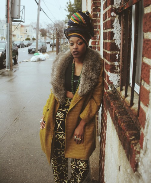 African street style with headscarf, coat and african printed pants