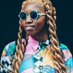 Amazing style with big twists, sunglasses and piercings