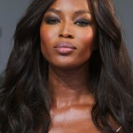 Beautiful Naomi Campbell with long wavy hairstyle