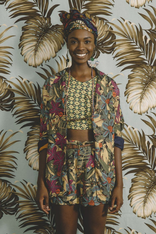 African fashion with headscarf, flowered jacket and shorts
