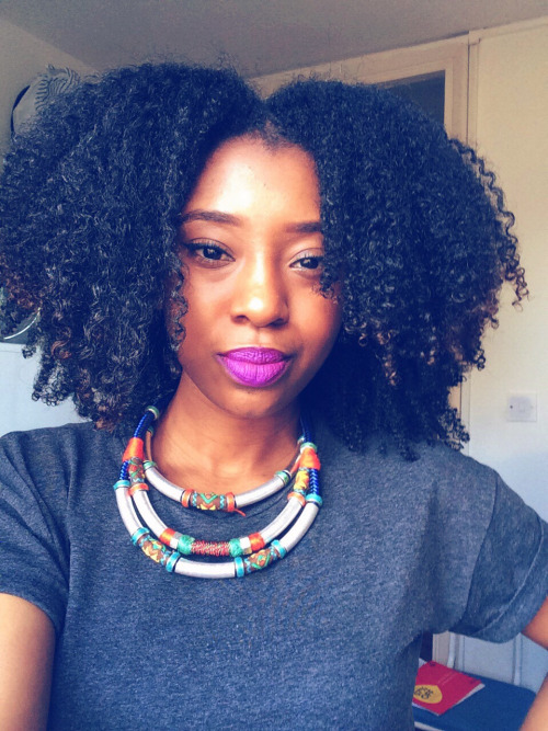 Coily natural hairstyle and nice necklace