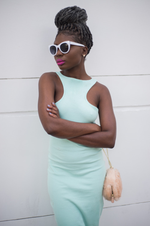 Tight dress, bright lipstick, white sunglasses and bun hairstyle