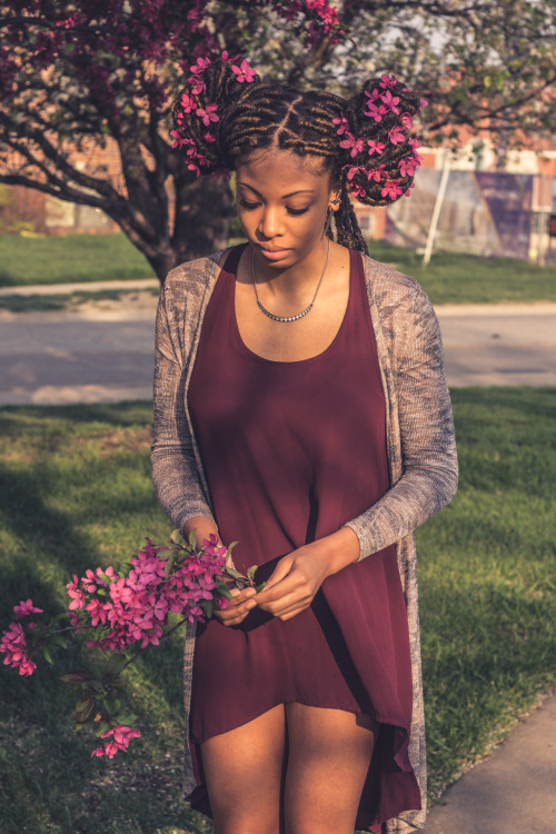 Amazing flowered hairstyle with locs and short dress