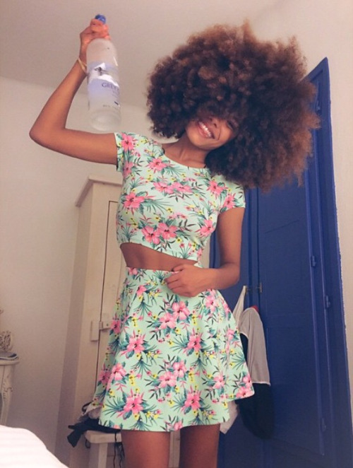 Gorgeous afro hairstyle and flowered skirt and top