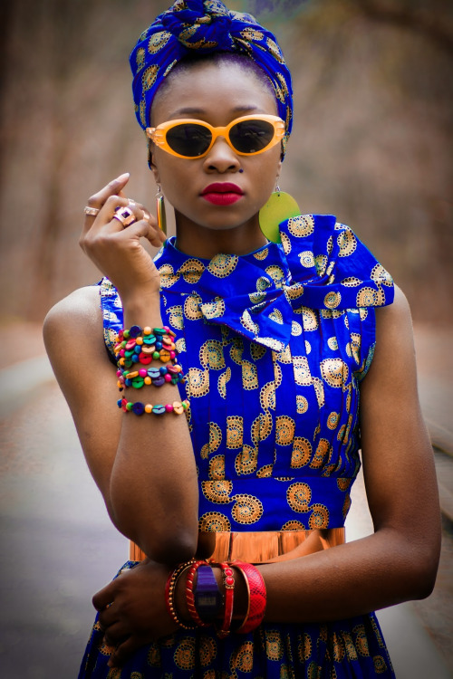 African fashion : dress and headscarf, sunglasses, bracelets...