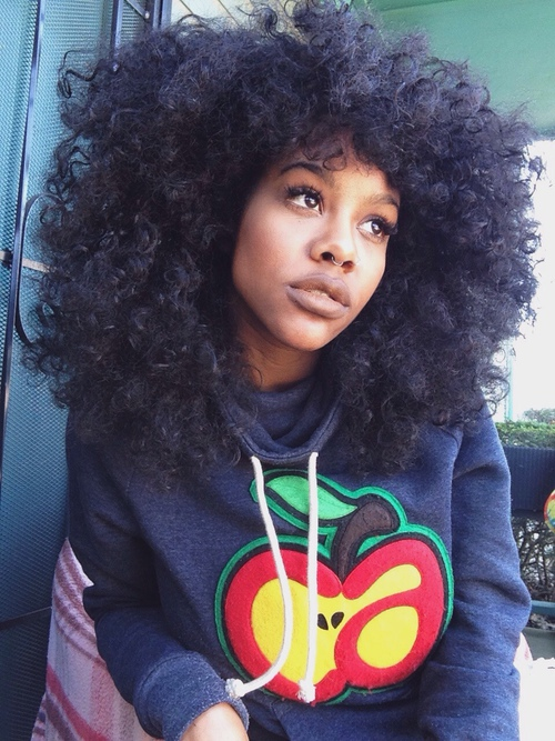 Gorgeous curly hairstyle and bull nose ring