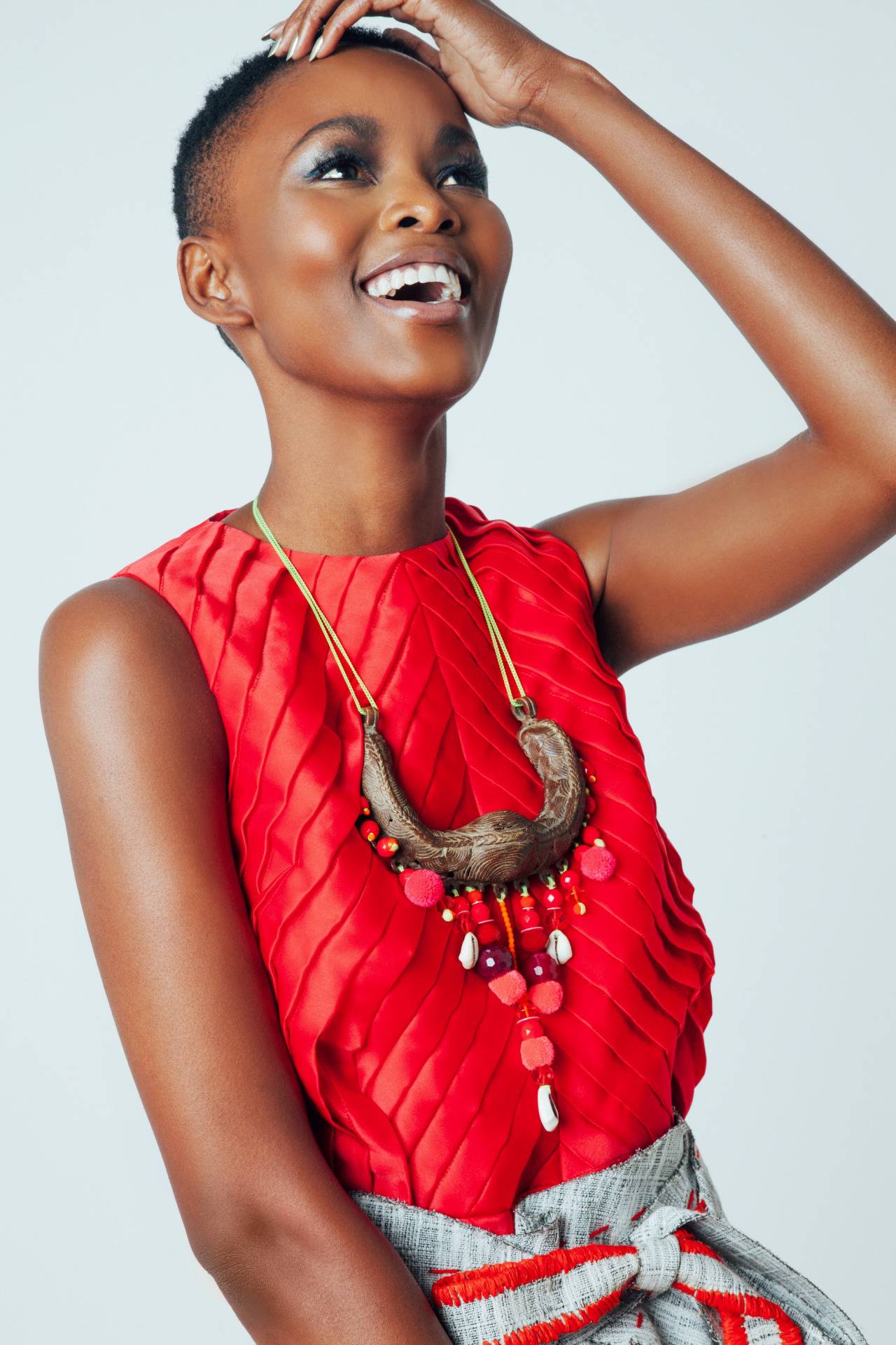 Flaviana Matata so beautiful with sleveless red top and big necklace